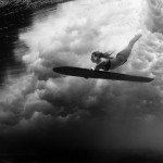Alison Duck Diving with a Hawaiian-style Surfboard